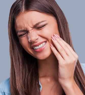 Боль в коронке зуба: причины и лечение